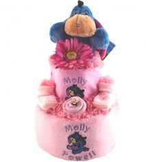 This gorgeous personalised 2 tier nappy cake for a baby girl features our most popular character – Disney's Baby Eeyore.  Piled high with official Disney products and practical nursery items, it's a baby shower or newborn gift in girly pink and will make your heart melt!