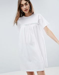 Buy it now. ASOS Smock Dress with Ruffles - White. Dress by ASOS Collection, Soft-touch jersey, Crew neck, Ruffle trim, Smock style, Loose fit � falls loosely over the body, Machine wash, 100% Cotton, Our model wears a UK 8/EU 36/US 4 and is 176cm/ 5'9.5� tall. ABOUT ASOS COLLECTION Score a wardrobe win no matter the dress code with our ASOS Collection own-label collection. From polished prom to the after party, our London-based design team scour the globe to nail your new-season fashion ...