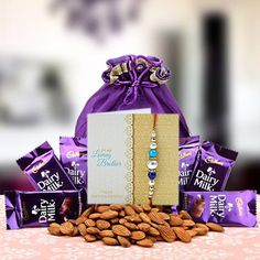 Check out our New Product  Almond and Chocolate Potli No Flower COD 6 cadbury dairy milk chocolate 14 grms, 200gms almonds with rakhi, roli and chawal  ₹799