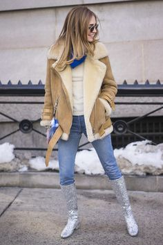 How the Street Style Pros Survive Winter in Style: Street style stars know that come fashion week, they're dressed in their best, no matter the temperatures.