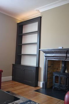 Timber shelves and cupboard into alcove