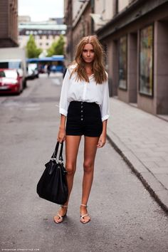 White button-down blouse, black high-waisted shorts, and strappy sandals