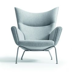 Lounge chair: CH445 Wing Chair   Hans J. Wegner   Danish design legend Hans J. Wegner sketched an upholstered easy chair with calm, clean lines and exceptional functionality. This chair was never put into series production until recently.