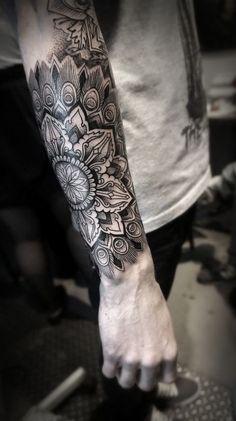 Awesome mandala sleeve tattoo.