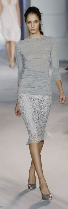 Love the ruching detail on this sweater - form-fitting, but I feel like it would be flattering too!