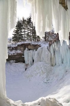 Minnehaha Falls, Minnesota.  Love how the water has frozen into a curtain of ice.  Seventy-Two Snowy Scenes THat Won't Make Your Toes Curl up with Cold