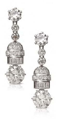 A pair of Art Deco platinum, white gold and diamond earrings. 3.2cm long. #ArtDeco