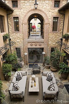 Luxury home atrium by Crodenberg, via Dreamstime.  Love this courtyard.    The best atrium home design ideas! See more inspiring images on our boards at: http://www.pinterest.com/homedsgnideas/atrium-home-design-ideas/