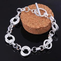 Bring stylish sophistication to any attire with this eye-catching fashion bracelet. Fashioned in sterling silver finished, this elegant design features duos of large polished curved oval links alterna