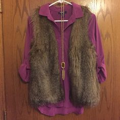 ON purple blouse 1/2 button up casual shirt with rolled sleeves which unroll to full length. Eggplant color. 100% polyester. Style for fall with a vest and statement necklace. Great condition. • No trades. No PayPal. • SHIPS SAME OR NEXT DAY! Old Navy Tops Blouses