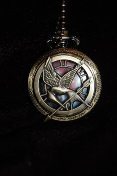 Hunger Games Catching Fire Mockingjay Pocket Watch Pendant Necklace. Love it so much!!!