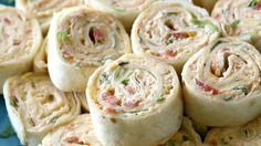 Who doesn't love pinwheels as an appetizer? Packed with chicken enchilada flavor, these are no exception.