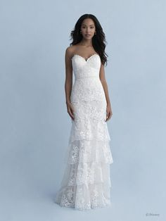 Disney Wedding Dresses 2020 - a beautiful collection of Disney Wedding Dresses and gowns from the Fairytale Wedding Collection. Browse these 16 Disney Wedding Dresses and Gowns inspired by the Disney Princesses Belle, Tiana, Snow White, Cinderella and Tiana. Disney Wedding Dresses, Princess Wedding Dresses, Disney Weddings, Wedding Disney, Princess Bridal, Bridal Gowns, Wedding Gowns, Strapless Lace Wedding Dress, Tiered Wedding Dresses