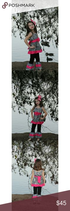 🔥🔥FLASH SALE $28🔥love Me Pink Boutique Outfit Be Bold Be Beautiful and Be Comfortable. Comes with top, pants and belt. Top has beautiful bold design with black and white with a pop of pink. Pants are black with elastic waist and beautiful ruffled pattern bottoms.  Boutique Quality and design dekoposh Matching Sets
