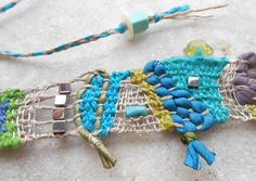 Sea colors - Hand woven mini Tapestry Necklace Slender, colorful and eye-catching: Freeform loom woven necklace in linen, silk and silver with Turquoise and Hematite gems and silver wire. The fine weaving in turquoise-green shades is worked with a mix of materials: linen yarn, silk