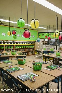 Hang colorful paper lanterns from the ceiling with ribbon. like color scheme and apple theme | 36 Clever DIY Ways To Decorate Your Classroom