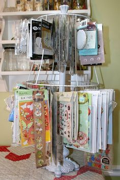 """Cheap embellishment stand - use an old lamp, pull the """"guts"""" out.  Take and old lampshade, take the shade portion off leaving the wire form.  Attach lamp shade to lamp and voila...embellishment stand!"""