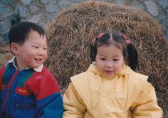 When I was young. With cousin Min-gyu Kim at the grave.