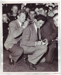 "Kaye and Garfield signing autographs for the troops of WWII at the Hollywood Canteen. Even though they aren't a couple of beautiful ""dames"" the troops still seemed interested in getting autographs from these two talented men. (Two of my all-time faves in one shot!!)"