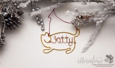 Attention cat lovers: This cute and personalized wire ornament will look great on your tree! Available in multiple color options at www.rlhcreations.com. #rlhcreations
