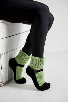 Looking for a pair of comfortable slippers for the house? You cant go wrong with these adult handmade knitted maryjane slipper socks. They look like theyre two separate pieces, but they are entirely 1 piece. The maryjane slipper is all black with a button on the side, while the sock is a beautiful tea green. The sock comes in the following sizes:    Sizes: XS between 6 - 7inches (15 - 18 cm)  S between 7 - 8.5 inches (18 - 22cm)  M between 8.5 - 9.5 inches (22 – 24 cm)  L between 9.5 - 11…