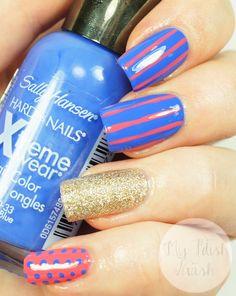 Stripes and dots nail art with Sally Hansen Pacific Blue and Coral Reef. #nailart #nailpolish #nails
