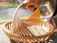 Love how handle is incorporated into this bamboo basket