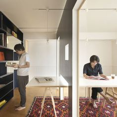 Wall moves to separate/adjust scale of living and working areas in small Tokyo apartment; Yuko Shibata