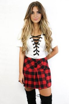 Classic red and black plaid skirt is an A-line skirt Material is Polyester and Cotton Not Lined Side Zipper Model Addi is 5'6 and is wearing a small Width Lengt