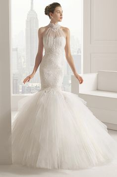 A stunning lace and tulle mermaid wedding dress with a matching tulle jacket. Rosa Clara, 2015