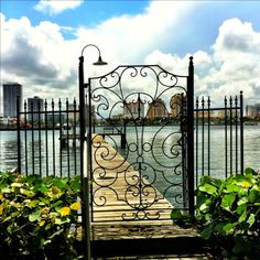 Palm Beach gated entrance to private dock overlooking Lake Worth intracoastal to West Palm Beach, FL