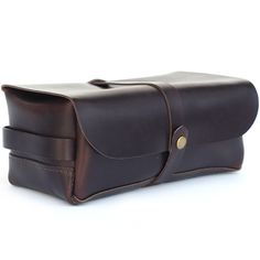 """Garden & Gun Magazine says it best, """"made of tough, wax-infused cowhide, Teranishi's handcrafted dopp kit marries ruggedness with a refined silhouette worthy of the modern travelin' man."""""""
