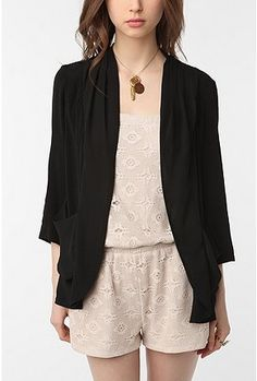 loose, open silhouette jacket over romper