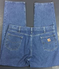 Mens Carhartt Jeans, Relaxed Fit. Tag says 42x34 but the jeans measure 41x33. B460DPS Medium Blue IRR