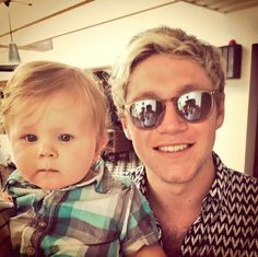 Niall and that baby!! Both are looking damn cute!