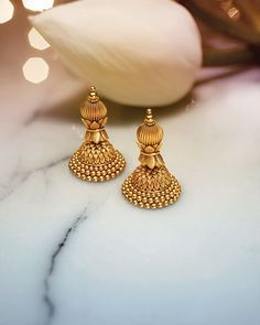 Explore exquisite temple jewellery inspired by temple art and architecture. This sublime collection of gold jewellery from Tanishq is an embodiment of grace and magnificence. Gold Jhumka Earrings, Gold Earrings Designs, Gold Jewellery Design, Antique Earrings, India Jewelry, Ear Jewelry, Bridal Jewelry, Gold Jewelry, Jewelry Holder