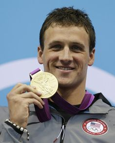 United States' Ryan Lochte poses with his gold medal for the men's 400-meter individual medley swimming final at the Aquatics Centre in the Olympic Park during the 2012 Summer Olympics in London, Satu