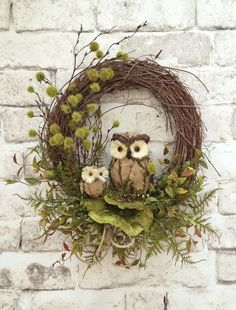 This charming owl wreath was handmade using a grapevine wreath base adorned with two adorable moss, burlap and twig owls, amazing green dried sponge mushrooms, lots of gorgeous mossy greenery, and a natural rope bow. This wreath has a very natural, organic look and feel to it that you will love!