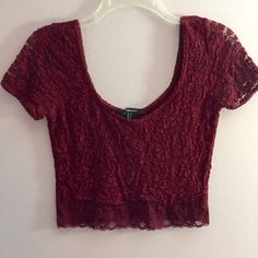Maroon lace crop top Red wine berry colored crop top all lace and with a scoop neck and scoop back. So adorable and comfortable. True medium fit! Absolutely love this paired with anything. Great Togo out in. Worn 3 times at most. So flattering. YES I bundleNO TRADES EVER no low balls. Don't ask to trade I will say no even if I love your closet. Negotiable ONLY USE OFFER BUTTON Forever 21 Tops Crop Tops