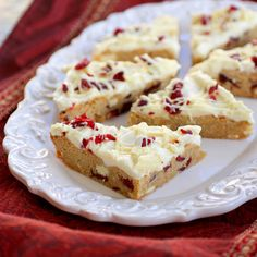 Cranberry Bliss Bars ••• Ingredients: salted butter, light brown sugar, large eggs, vanilla extract, baking powder, salt, ground cinnamon, dried cranberries, white baking chocolate, cream cheese, powdered sugar, grated orange zest ••• Get the recipe @ http://www.the-girl-who-ate-everything.com/2011/12/cranberry-bliss-bars.html