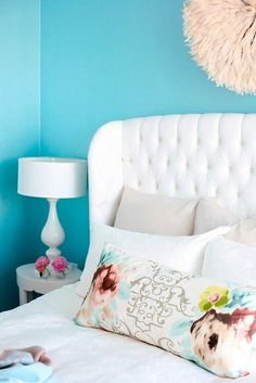 Awesome!!!! LOVE the blue and white color scheme, light fixture, headboard, pillows, and table/lamp!!