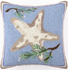 Over-stuffed and zippered this cream velvet backed cushion featuring a holiday starfish adorned holiday branches, is lovely blue pop of color.