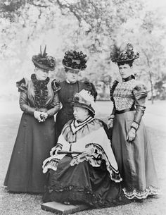 Queen Victoria with two daughters and a granddaughter, Standing left to right: granddaughter Princess Irene of Hesse; Victoria's youngest daughter Princess Beatrice; and Victoria's eldest daughter, Dowager Empress Victoria of Germany Queen Victoria Family, Queen Victoria Prince Albert, Victoria Reign, Victoria And Albert, Princess Victoria, Elizabeth Ii, Reine Victoria, Princess Beatrice, Queen Victoria
