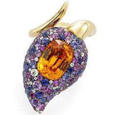 Designed by James Taffin de Givenchy, spessartine garnet, sapphire and diamond serpentine ring.