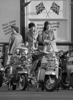 Mod girls at a UK beachfront sweets shop