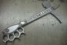 An all purpose heavy duty brass knuckles & pick- axe in one!
