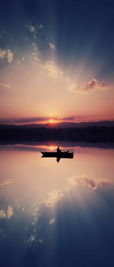 ~~Boat ~ sunset and reflections on a mirrorlike surface of a lake by Bess Hamiti~~