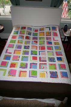 Twin size quilt #1 - front (displayed on a queen bed - I need a clothesline.)