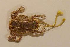 Sweet gold wirework frog purse from the 1600's, used for carrying herbs or perfumed sachets