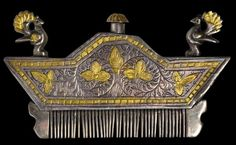 Northern Indian Silver Hair Comb--This comb from north-western India is hollow and has an internal well for perfume that then drips out small holes in the base and then run along the teeth of  the comb to perfume the hair or beard. The top of the well has a little top that screws in (clockwise).